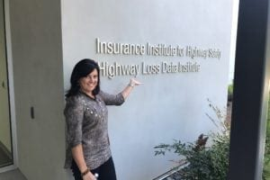 Becky with IIHS sign